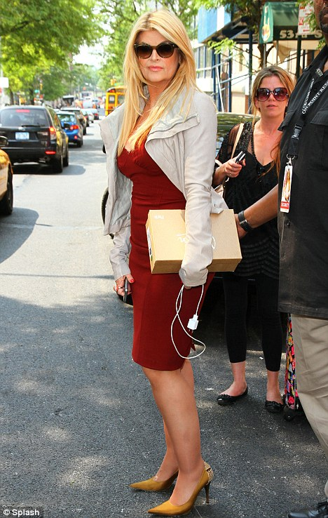 Kirstie Alley in a best red dress - Picture courtesy of the Daily Mail